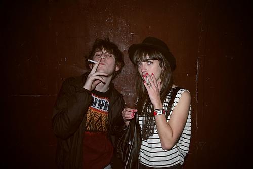 couple smoking cigarette