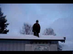 Guy on icy roof